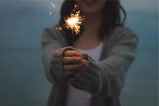https://pixabay.com/photos/sparkler-holding-hands-firework-677774/